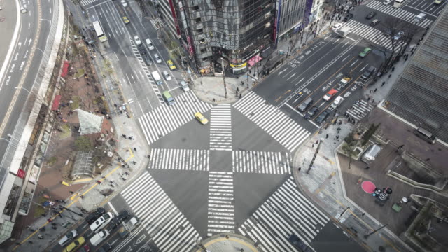 pedestrian crossing in the upmarket ginza district in central tokyo, japan. - ginza stock videos & royalty-free footage