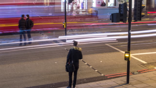 pedestrian crossing on london evening - time lapse - semaforo video stock e b–roll