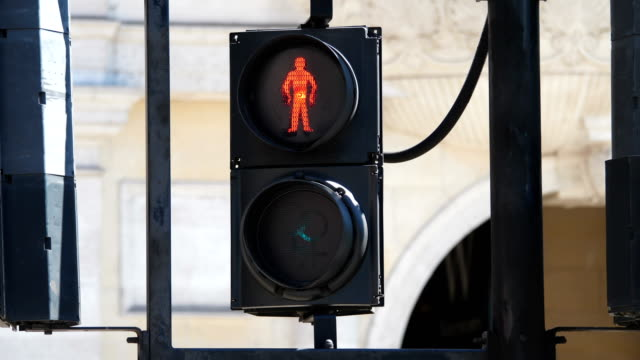 Pedestrian crossing singal with double female sign in London street