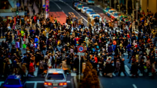 pedestrian crossing tokyo, japan miniature time lapse - road junction stock videos & royalty-free footage