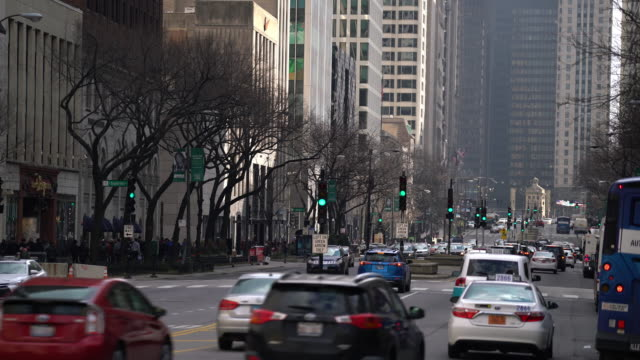 pedestrian crowded and car traffic transportation on magnificent mile michigan avenue shopping street district of chicago michigan avenue, united states.  american lifestyle concept and commuter transport. - michigan avenue bridge stock videos & royalty-free footage