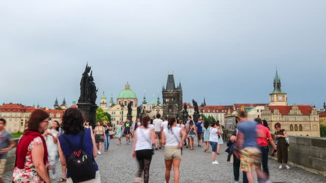 pedestrian crowded charles bridge czech aerial at dusk - mala strana stock videos and b-roll footage