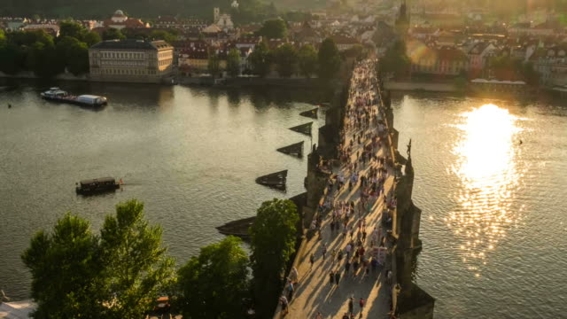 pedestrian crowded charles bridge czech aerial at sunset - mala strana stock videos and b-roll footage