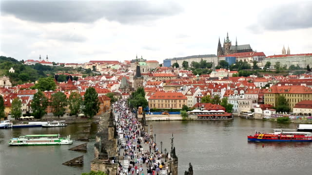 pedestrian crowded charles bridge karluv most czech republic - charles bridge stock videos and b-roll footage
