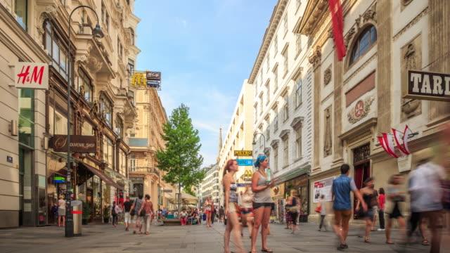 pedestrian crowded kartner shopping street vienna austria dusk - vienna stock videos and b-roll footage