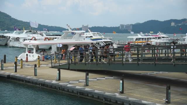 hd: pedestrian crowded sun moon lake harbor at taiwan - sun moon lake stock videos and b-roll footage