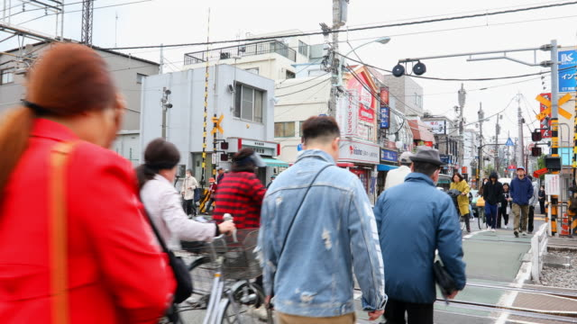 pedestrian crowds at a railway level crossing in tokyo - level crossing stock videos & royalty-free footage