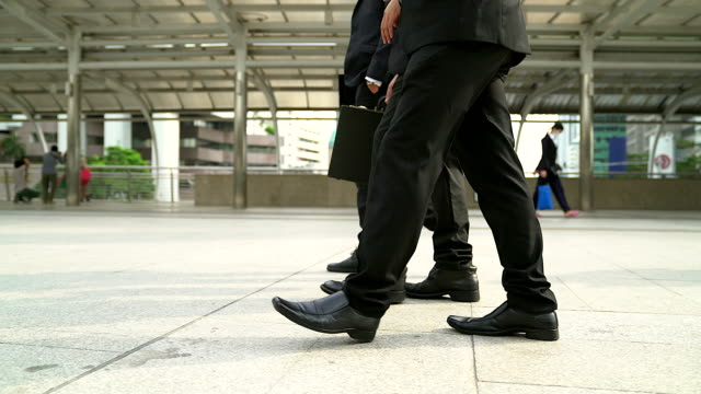 pedestrian in business suits crossing on the road, feet rushing through the traffic walk way. - suit stock videos & royalty-free footage