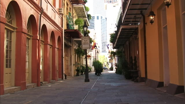 A pedestrian mall near downtown New Orleans features quaint lampposts and arched windows.