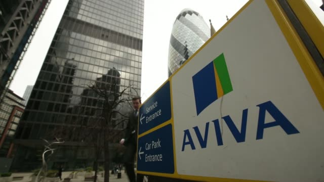 a pedestrian passes a sign outside the headquarters of aviva plc in london uk on friday march 7 visitors exit the aviva hq office building a... - weibliche angestellte stock-videos und b-roll-filmmaterial