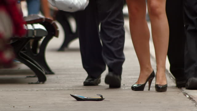 pedestrian picks up dropped wallet - wallet stock videos & royalty-free footage