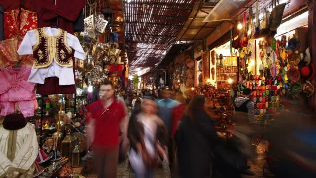 Pedestrian shoppers walk through the Souq in Marrakech, Morocco.