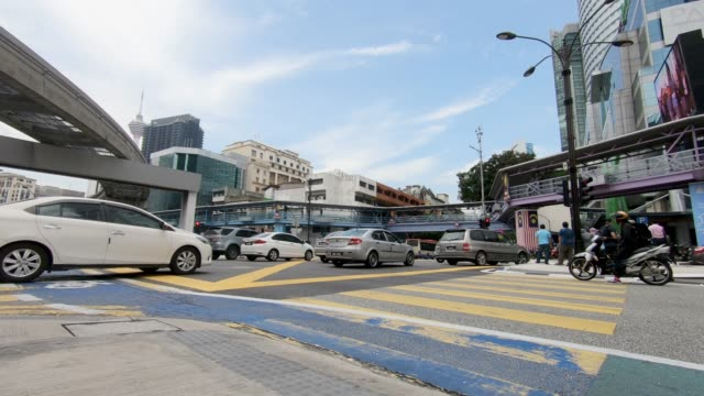 pedestrian traffic at a busy intersection - kuala lumpur stock videos & royalty-free footage