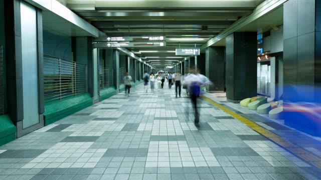 MS T/L Pedestrian traffic in Shinjuku business district / Tokyo, Japan