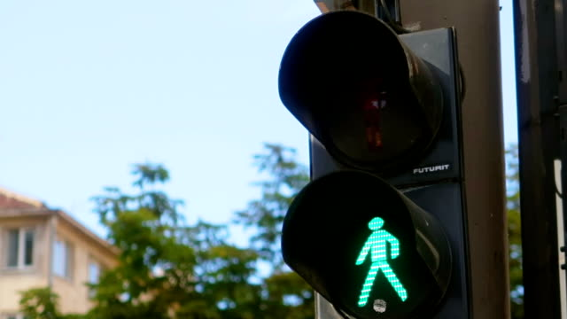 pedestrian traffic lights - green and red , urban atmosphere - pedestrian stock videos & royalty-free footage