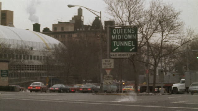 1978 montage ms pan pedestrian walking across street, traffic in background, new york city, new york state, usa - 1978 stock videos and b-roll footage