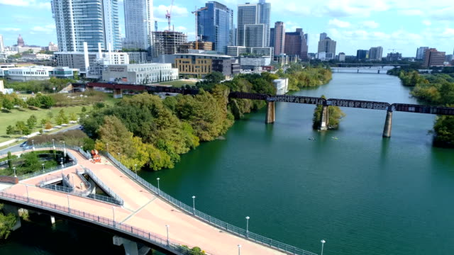 pedestrian walking bridge over town lake drone view austin , texas - footbridge stock videos & royalty-free footage