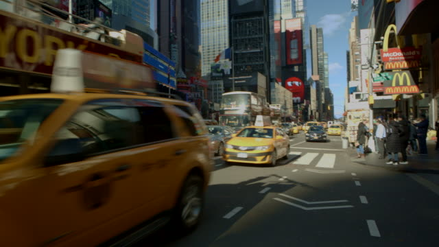 pov pedestrian walking in busy time square new york city - yellow taxi stock videos and b-roll footage