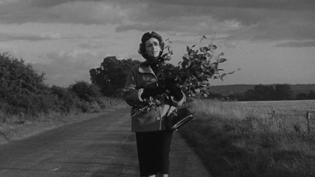1956 montage pedestrian walking in countryside and starting to run as she turns for home / united kingdom - vorderansicht stock-videos und b-roll-filmmaterial
