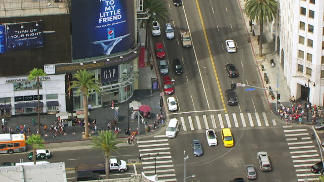 ws zo aerial pov pedestrian walking on hollywood walk of fame in front of hollywood and highland center, traffic at intersection / los angeles, california, united states - 2015 stock videos & royalty-free footage