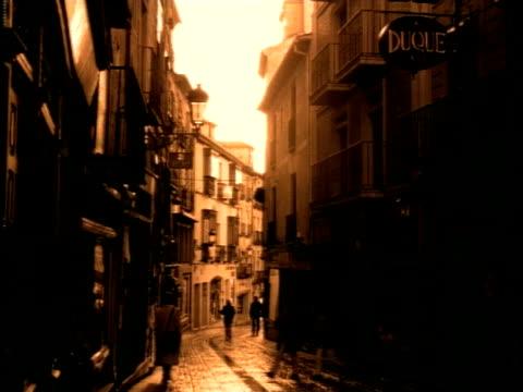 ms, pedestrian walking on narrow cobblestone street, sepia toned - sepia stock videos and b-roll footage