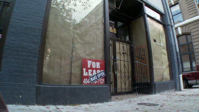 ms, td, pedestrian walking past shop for lease, atlanta, georgia, usa - sparse stock videos and b-roll footage