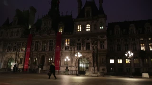 a pedestrian walks across the square du port de hotel de ville the headquarters of the municipality of paris and mayor's office in paris france on... - hotel de ville paris stock videos & royalty-free footage