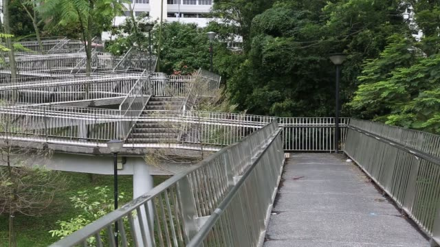 A pedestrian walks along a path in Queenstown estate in Singapore on Monday Jan 15 A commuter walks along a pedestrian walkway in Queenstown estate...