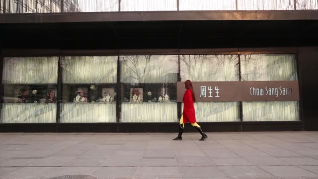 A pedestrian walks past the Chow Sang Sang Holdings International Ltd jewelry store in the Sanlitun district of Beijing Chow Sang Sang Holdings...