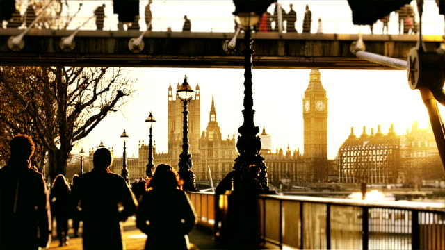 pedestrians and big ben at sunset - international landmark stock videos & royalty-free footage