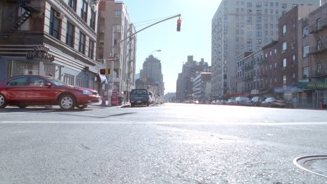 pedestrians and cars cross an intersection in new york city, new york. - 2001 stock videos & royalty-free footage
