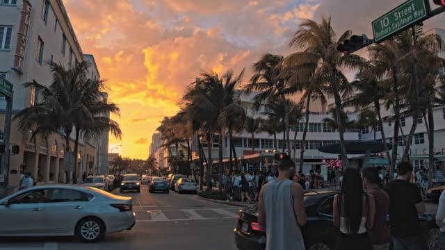 ms pedestrians and cars on urban streets of miami beach, miami, florida, usa - miami stock videos & royalty-free footage