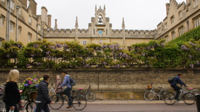 pedestrians and cyclists travel past sydney sussex college, cambridge. - cambridge university stock videos and b-roll footage