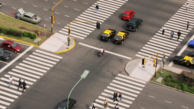 pedestrians and heavy traffic move through republic square in buenos aires, argentina. - plaza de la república buenos aires stock videos & royalty-free footage