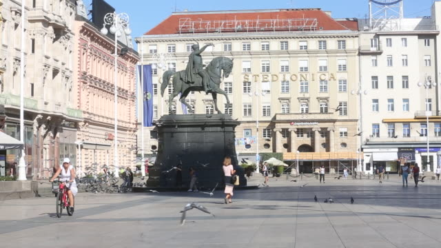pedestrians and pigeons on ban josip jelacic square in zagreb croatia got the green light to join the preeuro currency system last month and now have... - zagreb stock videos & royalty-free footage