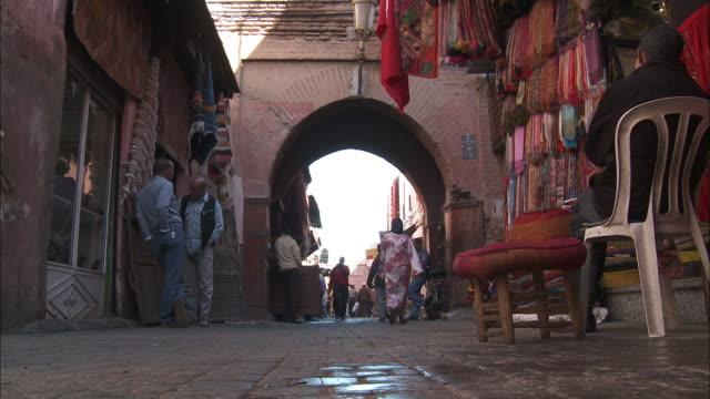 Pedestrians and shoppers pass through a souk in Marrakech.