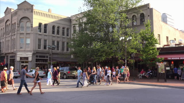 Pedestrians and tourists crossing the street in downtown Asheville, North Carolina