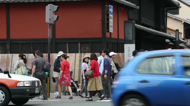 pedestrians and tourists walk along a street in kyoto japan tourists wearing rental traditional kimonos for maiko an apprentice geisha walk through... - gion stock videos and b-roll footage