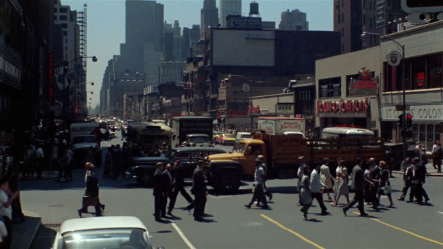 vídeos de stock, filmes e b-roll de 1960 ws zi pedestrians and traffic in 6th ave, new york city, new york, usa - 1960