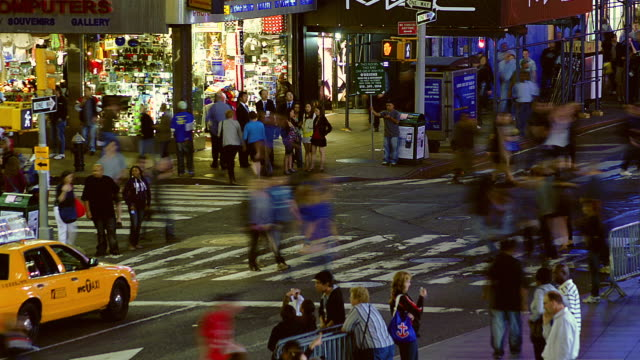 T/L Pedestrians and traffic in Times Square at night / New York, New York, United States