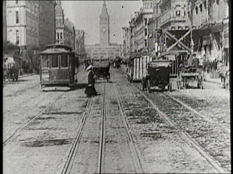 Pedestrians and traffic move erratically down Market Street in San Francisco in 1912