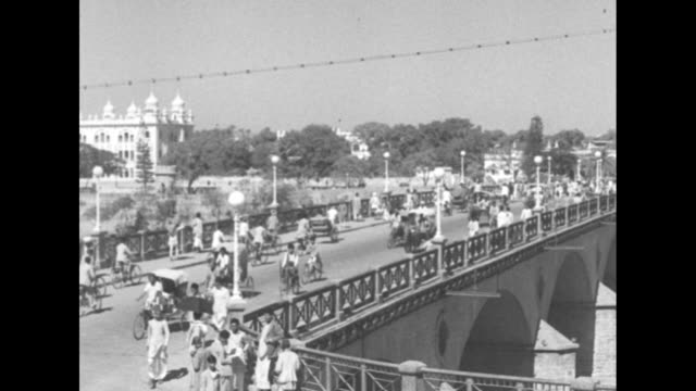 Pedestrians and traffic moves over bridge pan to the Hyderabad town hall in the background / WS EXT building / Note exact day not known documentation...