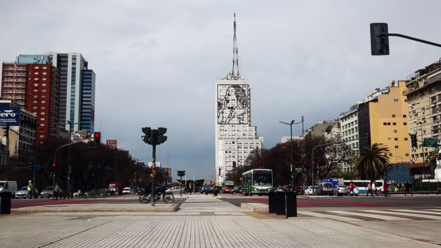 Pedestrians and traffic on Av 9 De Julio on September 30 2014 in Buenos Aires Argentina