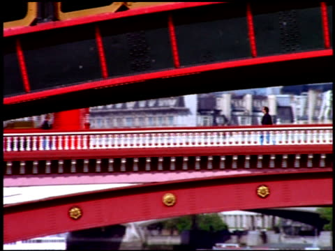 pedestrians and traffic on blackfriars bridge with blackfriars railway bridge in foreground, london - railway bridge stock videos & royalty-free footage
