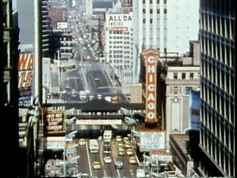 vidéos et rushes de 1963 montage pedestrians and traffic on busy downtown street / chicago, united states / audio - chicago illinois
