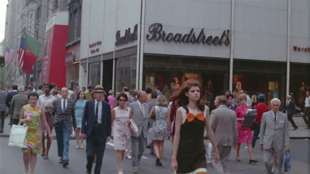 1969 MONTAGE Pedestrians and traffic on busy Manhattan street / New York City, New York