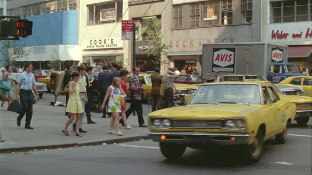 vídeos de stock, filmes e b-roll de 1965 ms pedestrians and traffic on busy manhattan street / new york city, new york - 1965