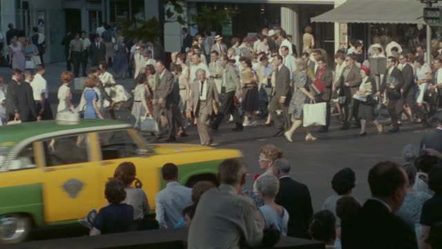 1959 ha ws pedestrians and traffic on busy manhattan street / new york city, new york - 1950 1959 stock-videos und b-roll-filmmaterial