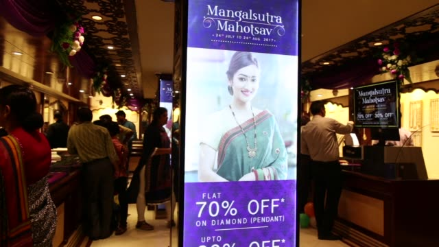 Pedestrians and traffic pass in front of the PN Gadgil Jewellers Pvt flagship jewelry store in Pune India on Monday Aug 17 Pedestrians walk past the...
