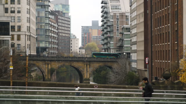 pedestrians and traffic pass over bridges of the river irwell, manchester - manchester england stock videos & royalty-free footage